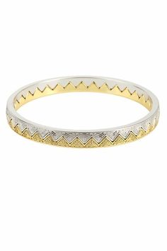 Silver and gold, LEVEL I: This House of Harlow bangle goes halfsies and couldn't be more versatile.