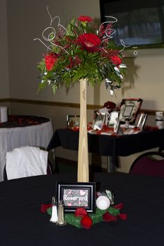 HAHA.. baseball wedding centerpieces... Brendan would probably be ok with spending money at tucci for these...