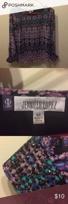 Jennifer Lopez Sexy Open Sleeve Top Hardly worn Jennifer Lopez open sleeve top with purple and blue geometric patten. Black rhinestone studded cuff. Jennifer Lopez Tops Blouses