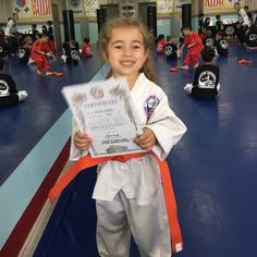 #delilahreese got promoted to orange belt today. Youngest little #tkd in class. #championTKD by olivesberger