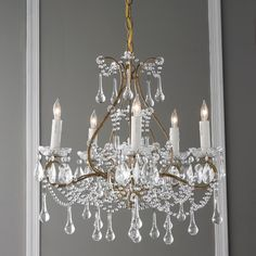 Vieux Quartier Crystal ChandelierWith an homage to French splendor from the past, this 5 light crystal chandelier has an antique elegance that adds a graceful touch to modern interiors. Smoky gold frame with dainty crystals, perfect for bedrooms, entry foyers and powder rooms. (18Hx19W)