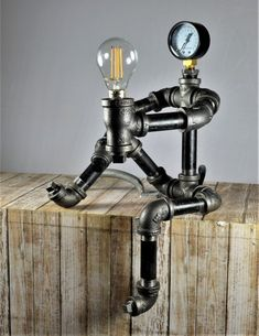 I made this Steampunk Robot desk lamp with iron plumbing pipes and fittings. The Lamp . Pipe Furniture, Industrial Furniture, Industrial Pipe, Industrial Lighting, Lampe Steampunk, Desk Lamp, Table Lamp, Pipe Decor, Pipe Lighting