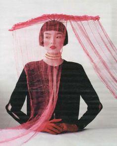 Straight bang short bob.  Asian model.  Editorial photo.