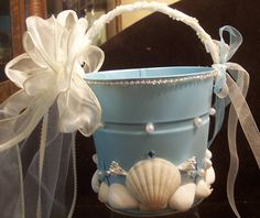 """BEACH WEDDING FLOWER GIRL !!! This flower girls beach pail is adorned with genuine seashells, beads, ribbons and silk flowers. Ribbon colors can be changed to coordinate with wedding colors. Just fill this pail with your favorite flower petals and listen to the all the """"Ahhs and Ooohs!"""""""