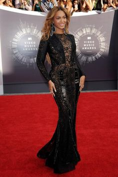 Queen Bey looked flawless in a full-length figure-hugging gown by Nicolas Jebran. The combination of lace and beads on the dress was perfect. The gown also featured sheer, embellished sleeves and side panels.  http://famehorsewire.com/red-carpet/2014-vmas-red-carpet-wore-best-picks/759/