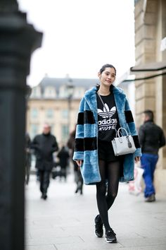 Stripes in street style. Super Coll striped faux fur on model Ming Xi off duty in Paris. #style #fashion #stripes
