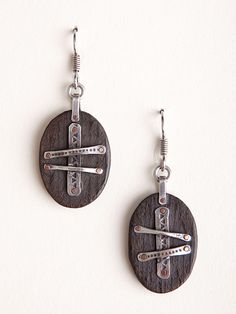 These rustic earrings are made from rich ebony wood and have beautiful silver and copper details. Each earring is handcrafted by Master Ilya Kazakov and are crafted using traditional Kazakh techniques