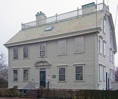 Hunter House in Newport, Rhode Island, was begun in 1748 for Colonial Deputy Governor Jonathan Nichols, Jr. The architecture is Georgian Colonial. This large 2½-story house has a balustraded gambrel roof. In 1756, the property was sold to Col. Joseph Wanton, Jr., who was a deputy governor of the colony & a merchant. Wanton enlarged the house by adding a south wing & a second chimney, transforming the building into a formal Georgian mansion with a large central hall.