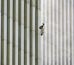 A person falls from the north tower of New York's World Trade Center Tuesday Sept. 2001 after terrorists crashed two hijacked airliners into the World Trade Center and brought down the twin towers. (AP Photo/Richard Drew)(The Falling Man) World Trade Center, Trade Centre, The Falling Man, Person Falling, We Are The World, Change The World, Geo Magazine, Photo Choc, Remembering September 11th