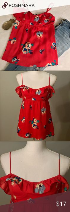 """American Eagle Outfitters red floral tank top American Eagle Outfitters red floral tank. Red tank top blouse with colorful floral print. Silky, flowy, lightweight material. Empire waistline for flattering silhouette. Ruffle sweetheart neckline with defined cups. Adjustable spaghetti straps. Elastic band on back for better fit. Size small. EUC, excellent used condition. Measurements taken laid flat. 16"""" bust, 14"""" waist, 25"""" length. American Eagle Outfitters Tops Tank Tops"""
