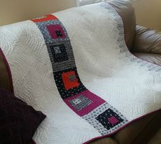 Cozy modern quilt with wavy quilting by Mountain Quiltworks