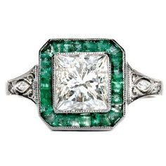 Gorgeous vintage engagement ring. If only that had rubies around it instead of emeralds.