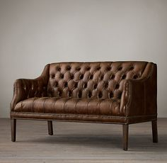 "VERETT TUFTED LEATHER SETTEE - 53""W X 31""D X 33""H $2525   Stocked in Vintage Cigar."