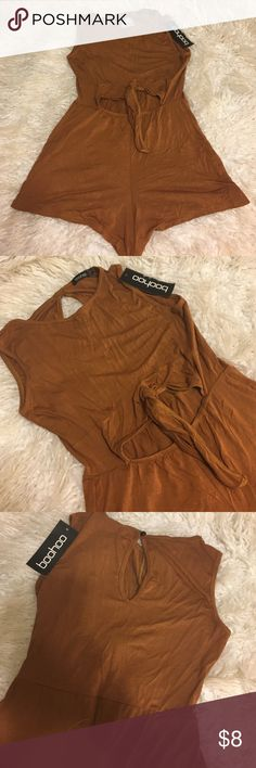 """Boohoo romper Unworn boohoo romper. US 4. Would fit someone who wears a small or XS. Open front to expose stomach and open hole in the back. Very short like """"booty shorts"""" Boohoo Other"""