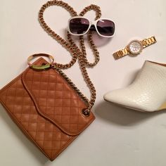 Amazing Rebecca Minkoff Bag Brown leather bag in excellent condition by Rebecca Minkoff. Gold hardware. No marks or stains. Dimensions are approximately 8.5 inches across and 7 inches tall Rebecca Minkoff Bags Crossbody Bags