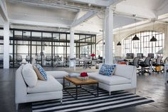 To capture the look and feel of a start-up, Meyers and Zea toured the offices of e-commerce companies including Moda Operandi, Nasty Gal, and One Kings Lane for inspiration. The production design team built glass-walled conference rooms as part of the open-plan office, and sofas from CB2 were added to the lounge areas.
