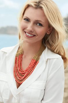 White top with a coral necklace