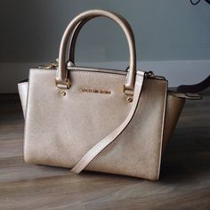 MICHAEL KORS - Med Selma Satchel NWOT- Never used still with original stuffing - Pale Gold saffiano leather - too handles and cross body/shoulder strap - comment with any questions - happy to answer! Also open to reasonable offers! Michael Kors Bags Satchels