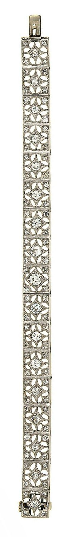A diamond bracelet Composed of a series of square panels pierced with quatrefoil motifs, set with old-cut diamonds, 18.0cm long