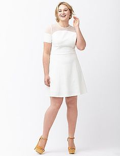 Flirty fit & flare dress from ABS by Allen Schwartz brings modern edge to any occasion with sheer mesh detailing and a flattering fit for you. Soft textured knit is a hit for the season with just the right touch of stretch and seams to define curves in all the right places. Short sleeves. lanebryant.com