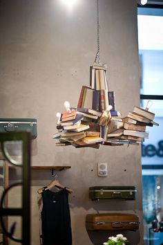 d6a9bb6b4cd Light fixture made with books.Anthropologie Store Display by all things  paper…