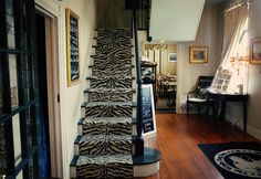 I love touches like this zebra print staircase runner. It& just so unexpected and fun. I took this photo from the bar area and we ate in the room directly . Carpets Online, Hallway Carpet Runners, Carpet Stairs, Zebra Print, Animal Print Rug, Black Stairs, Staircase Runner, Cost Of Carpet