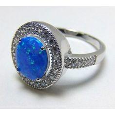Pierścionek srebrny pr. 925. Kamień - syntetyczny opal australijski.