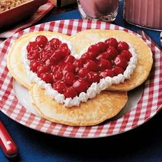 Sweetheart Pancakes Recipe -Hot-off-the-griddle goodies are always a welcome sight put on the table...morning, noon and night. Instead of serving these palate-pleasing pancakes with ordinary maple syrup, make this extraordinary cherry sauce. You'll be thanked mmm-many times over!