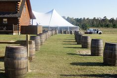 whiskey barrels lining the path to the reception