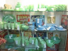 A display of Jadeite Fire King in an antique shop. Rarer blue Azurite milk glass tableware is also shown.Photos by Mavis on Flickr.