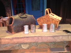 "A sample of the bar mugs that were used in ""Omm Pa Pa"" along with a basket for the kittens to be in that widow corny has in the second scene of the show. Along with a historical doctors bag carried by the doctor. This bag belonged to Edgar tufts back in the 1800's."