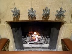 You can't beat a traditional open fire with festive decorations. We're all ready for Christmas in The Cotswolds at Calcot Manor.
