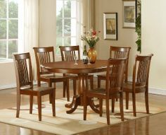 East West Furniture P7-SBR-W Portland 7PC Set with Single Pedestal Oval Dining table featured 18 in. extension Leaf and 6 wood seat chairs by East West Entertainment. $2882.25. Chair backs have vertical slats with scrolled tops, completing the stylish looks. Chairs are available upholstered in contrasting light fabric. Solid wood dining set finished in a warm saddle brown to compliment almost any decor. Columnar pedestal with subtle accents add a touch of classic flair. Oval ...