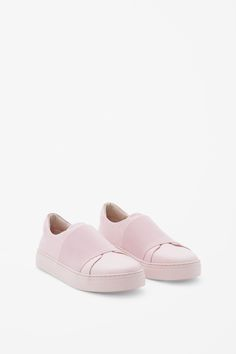 A clean minimal style and a slip-on design, these sneakers are made from panels of smooth leather with an elastic wrap-over detail and completed with a tonal rubber sole.
