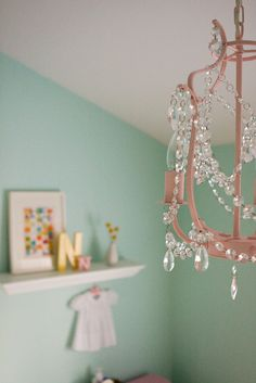 Recycled watermelon pink nursery chandelier decorated with faux she bought this chandelier from ikea and spray painted it pink aloadofball Choice Image