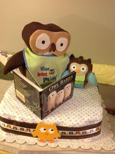 Owl Babies diaper cake with Momma Owl made from diapers and paired with a cute owl stroller toy and board book.