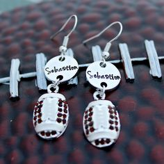 Football lovers everywhere, you can show your Love for your Favorite Player with these Beautiful Earrings. Hand stamped with your favorite Player's jersey number and a cute football charm. These will