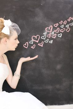 Cute chalk hearts idea for chalkboard photo booth.