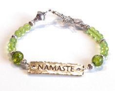 GREEN with Silver and NAMASTE Women's stackable bracelet, stacking bracelet, statement bracelet, beaded bracelet by dunglebees. Explore more products on http://dunglebees.etsy.com