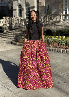 A pink and yellow print maxi skirt. This style is elegant and so fun. I love bold patterns that create a unique look. Maxi skirts are easy to style and are timeless. Wear a maxi on date night, girls night out, baby showers. Printed Maxi Skirts, Skirts For Sale, Yellow Print, Gray Skirt, Skirts With Pockets, Girls Night Out, Modern Fashion, African Fashion, Ready To Wear