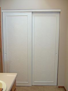 Remodelaholic | Frugalicious Closet Door Makeover, Monthly Contributor using paintable wallpaper and trim