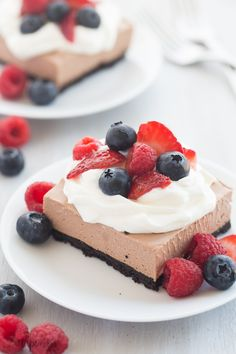 These No Bake Chocolate Nutella Cheesecake Bars are SO easy and perfect for topping with fresh berries! Rich, creamy and no oven required!