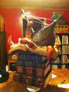 The top is cool, but I like it just for the stack of books!