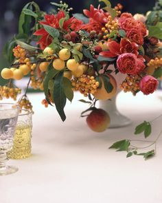 Fruit on the vine imparts alluring arches in this lush centerpiece.