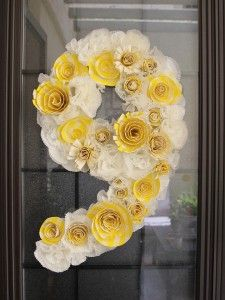 cupcake liner birthday number wreath. Could alter to make the grad's year and hang it on the wall or on the front of the house