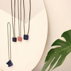I love minimalism as an art movement, as a design movement, as a life style, and as an attitude towards consumerism.   The necklaces in the picture come from two different series. The necklace on the lower left side is one of three blue necklaces. The other ones, slightly smaller, come from a series of 4 blue one and a pink one. The all represent an irreparable moment in time, the moment they have been created. Design Movements, Blue Necklace, Consumerism, Wind Chimes, Minimalism, Attitude, Necklaces, Create, Outdoor Decor