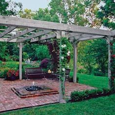 A freestanding pergola and outdoor fire pit make this spot an attractive backyard destination. Learn more ways to elevate your hardscaping from our Pinterest board Outdoor Living. | Photo Richard Felber (Styling by Michelle Lay) | thisoldhouse.com