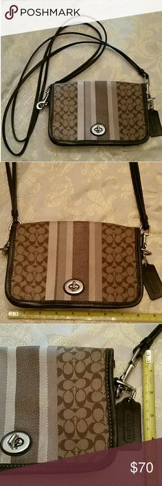 """Coach multicolor brown crossbody glitter stripe Coach multicolor brown crossbody with glitter stripes in center of pattern and Coach monogram. Front flap with turn  closure. About 8"""" W, 5"""" L and  21"""" drop. Dual leather straps as pictured. Make up stain inside as in last picture. Coach Bags Crossbody Bags"""