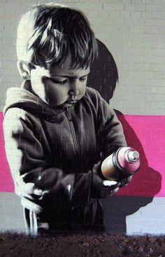 Young street artist on graffiti street  art