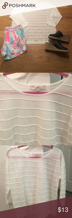 """LOFT white semi sheer sweater LOFT white semi sheer sweater top size medium in great condition. This has a loose crew neck and 3/4 sleeves. This has a ribbed look with lines like a seam. 89% rayon and 11% nylon. 22.5"""" length and 19.5"""" chest LOFT Sweaters Crew & Scoop Necks"""